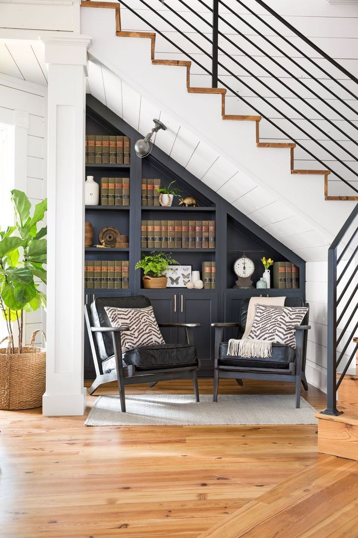 Black book shelving under the stairs and the reading zone near