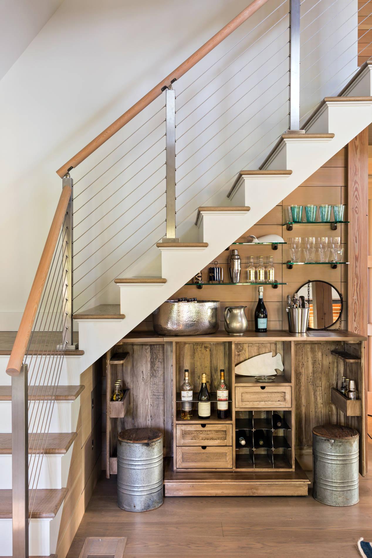 Wine storage under the stairs as an original deisgn insight