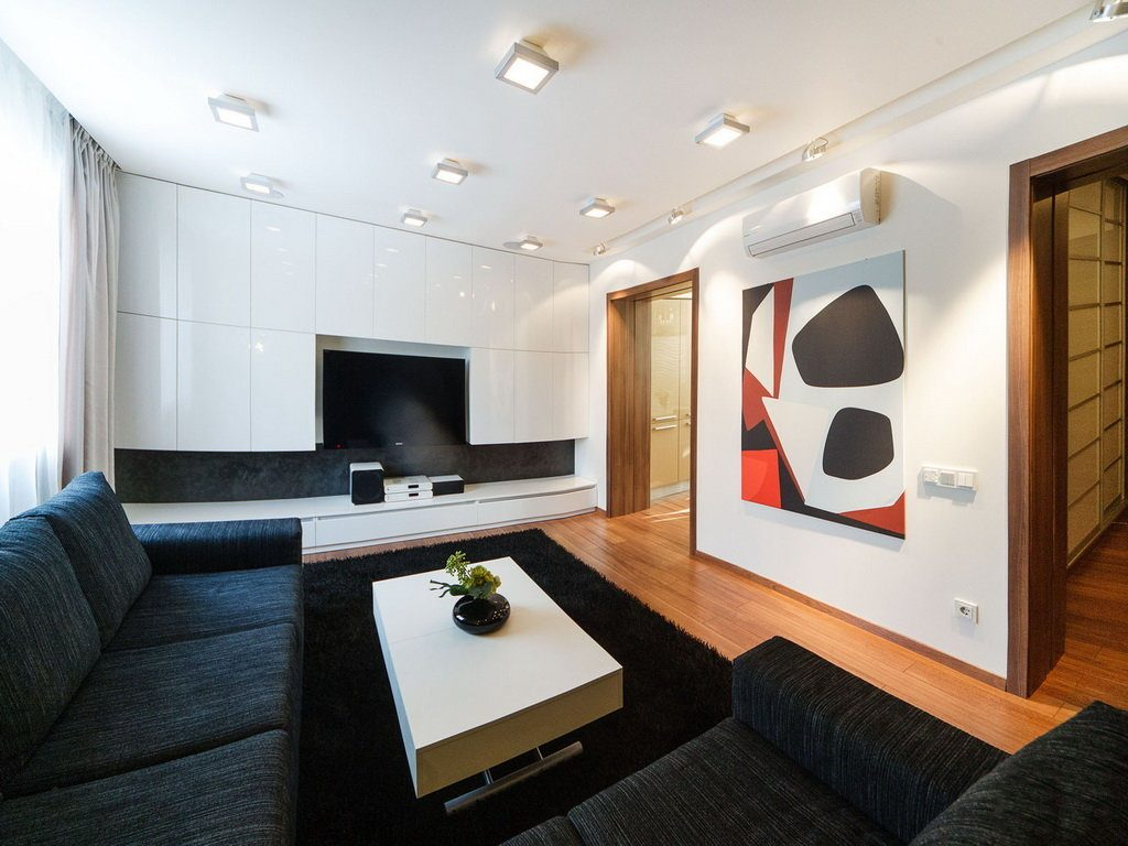 Marvelous modern design of the living room with black chatting zone and white walls