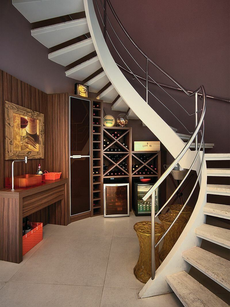 Spiral staircase at the fashionable interior with home office under the staircase