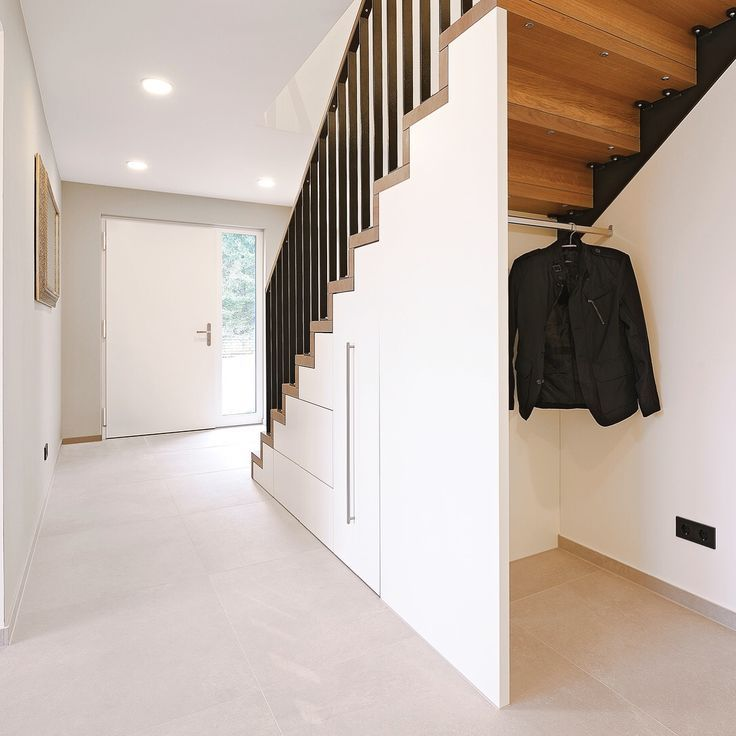 Storage under the Staircase: Different Ideas and Functional Spaces. Improvised clothes cabinet with open hanger