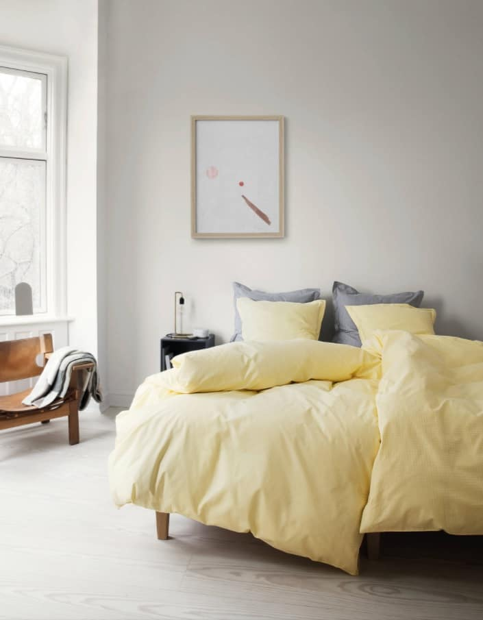4 Must-Have Bed Coverings You Cannot Miss. Mild yellow duvet and pastel painted room
