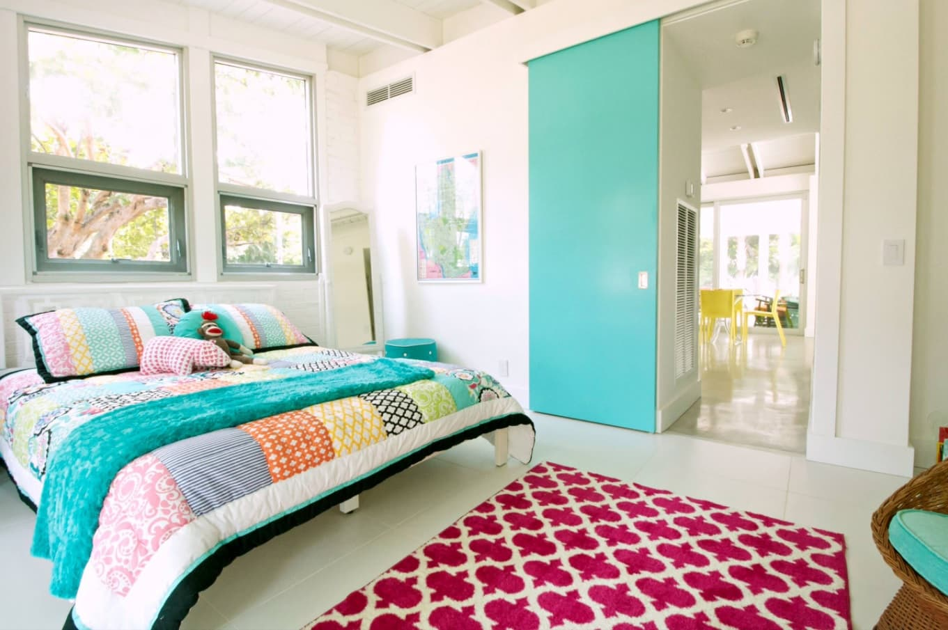 4 Must-Have Bed Coverings You Cannot Miss. Unusual modern styled design of the room with red patterned rug and turquoise sliding door