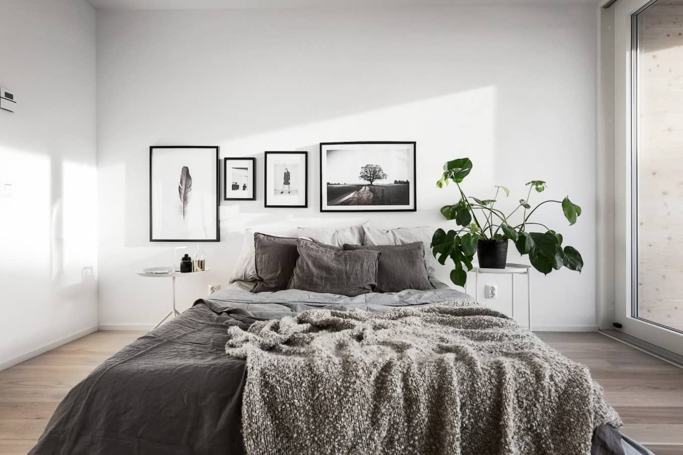 4 Must-Have Bed Coverings You Cannot Miss. Minimalistic Scandinavian design of the bedroom with gray bed linen