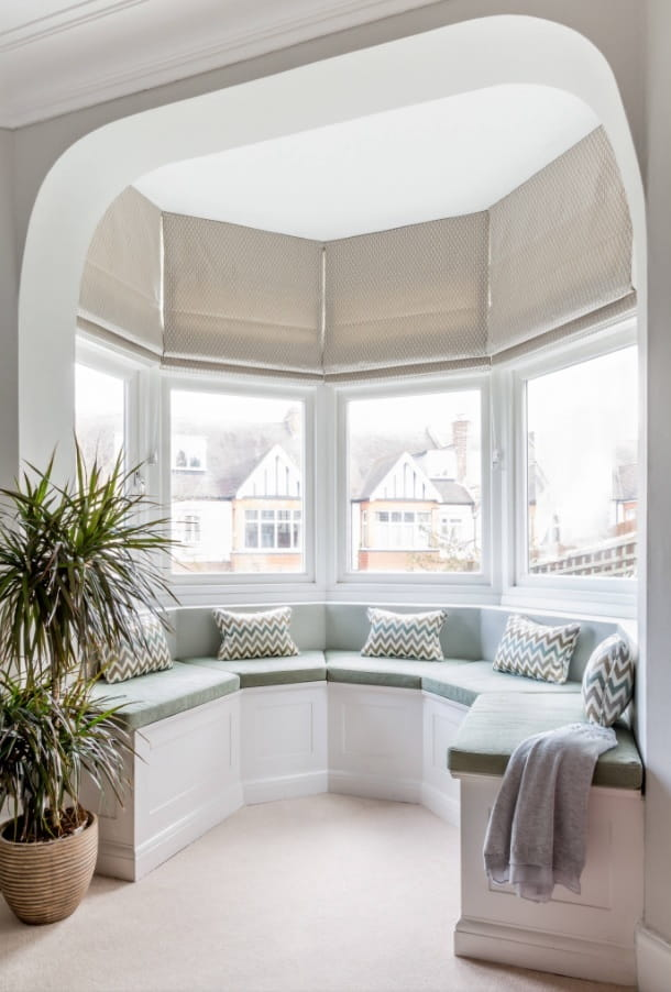 Why Double-Glazed Windows Are Still the Best. Casual styled bay window with seating zone
