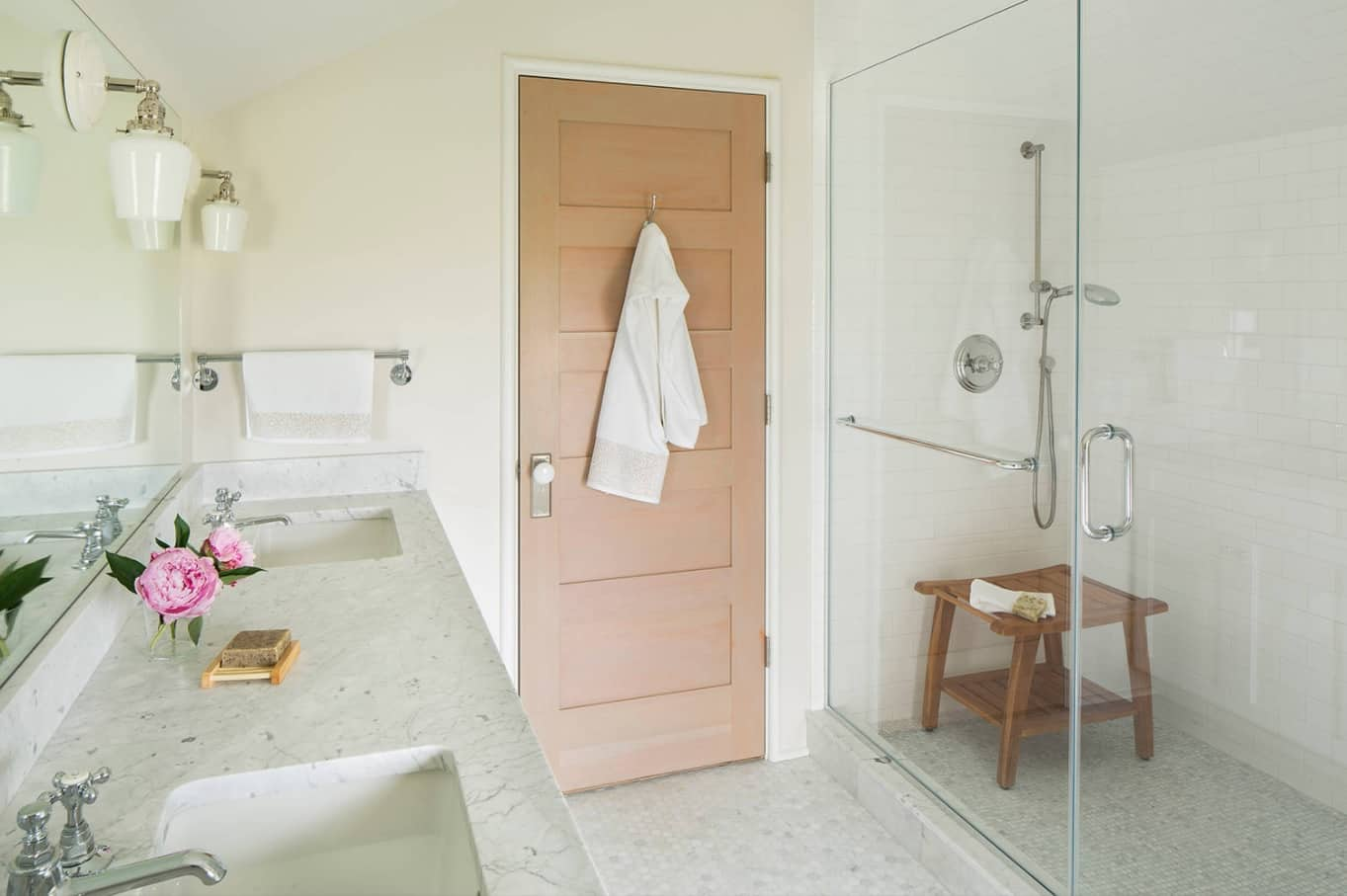 Making the Most of a Small Bathroom. Contemporary styled bathroom in pastel colors with wooden door