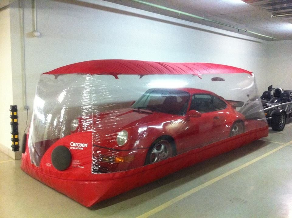 How To Store Your Vehicle in the Winter. Red inflatable garage