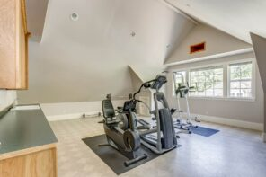 4 Tips to Create a Home Gym Out of a Small Space. Exercise bike at the loft improvised gym