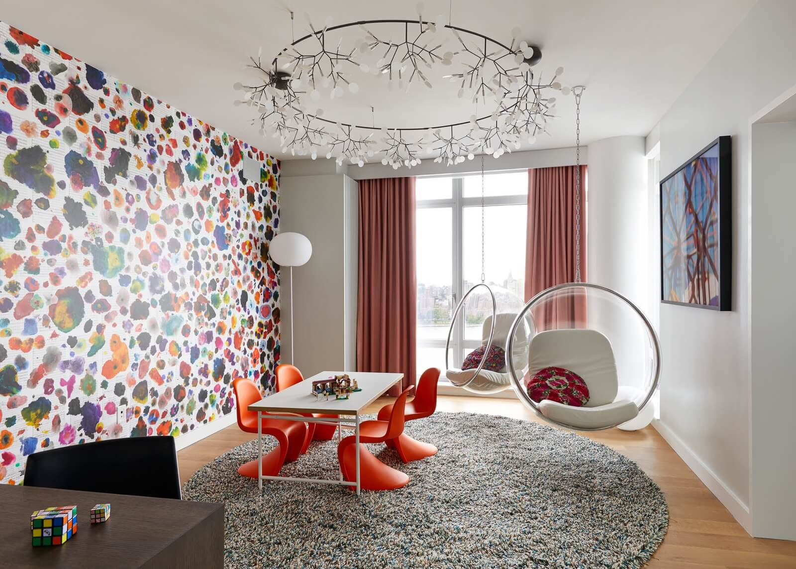Wallpaper Design Ideas 2020 to Make Interior Elegant. Great idea with orange chairs and colorful impression on the wall