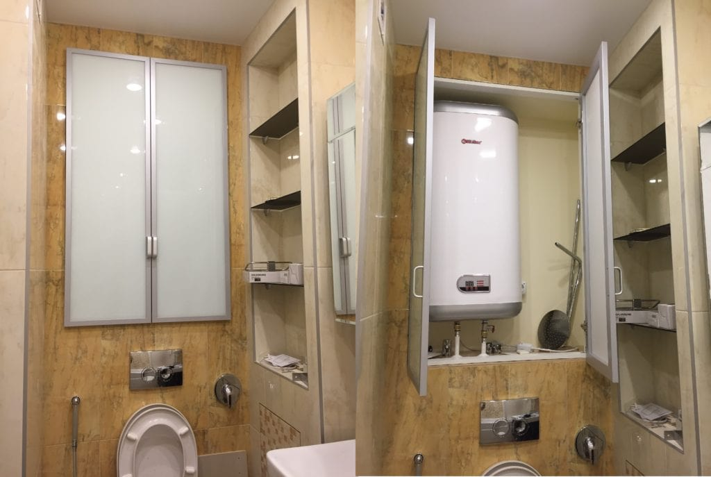 4 Main Reasons Why Electronic Ignition Water Heater Won't Light. Appliances hidden in the niche of the small bathroom