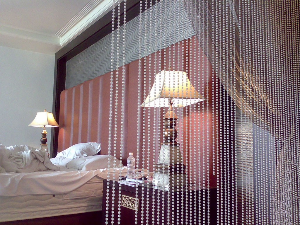 Classic bedroom design with interior bead woven curtains
