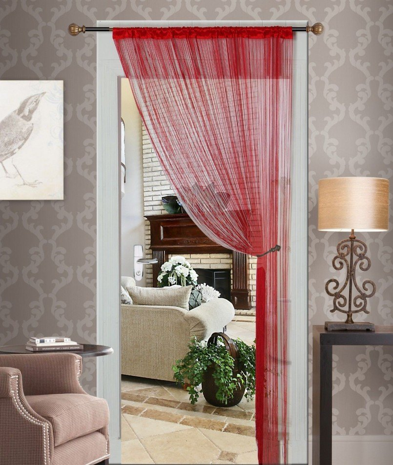 Red tulle interior curtain and gray silkscreen wallpaper
