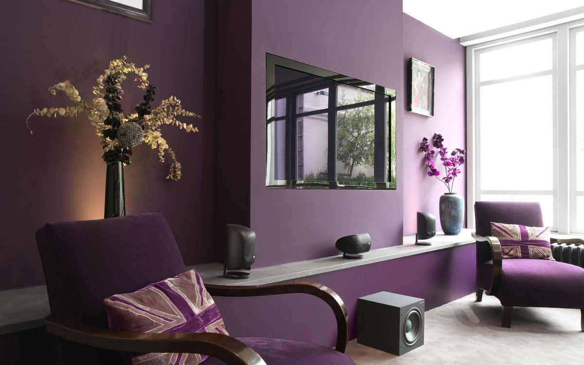 Deep purple colored wall with built-in TV-screen