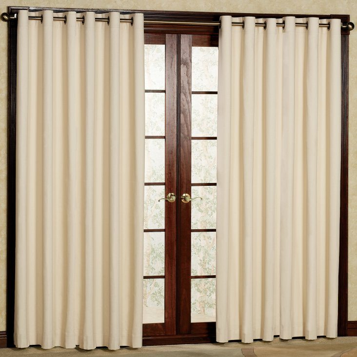 Simple door design and creamy interior curtains on the rod