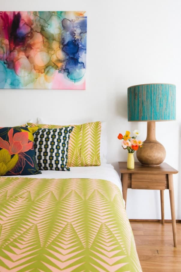 Space-Saving Solutions: Bedroom Design Ideas for Small Homes. Colorful theme in the minimalistic interior with white walls