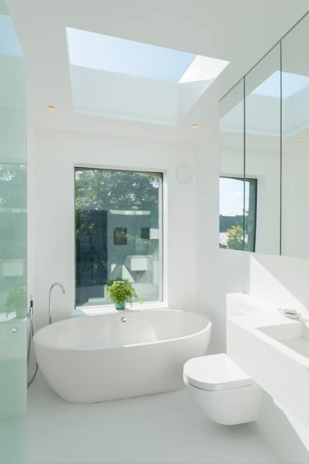 5 Ways to Improve Your Bathroom. Freestanding eggshell bathtub as an accent of the bathroom