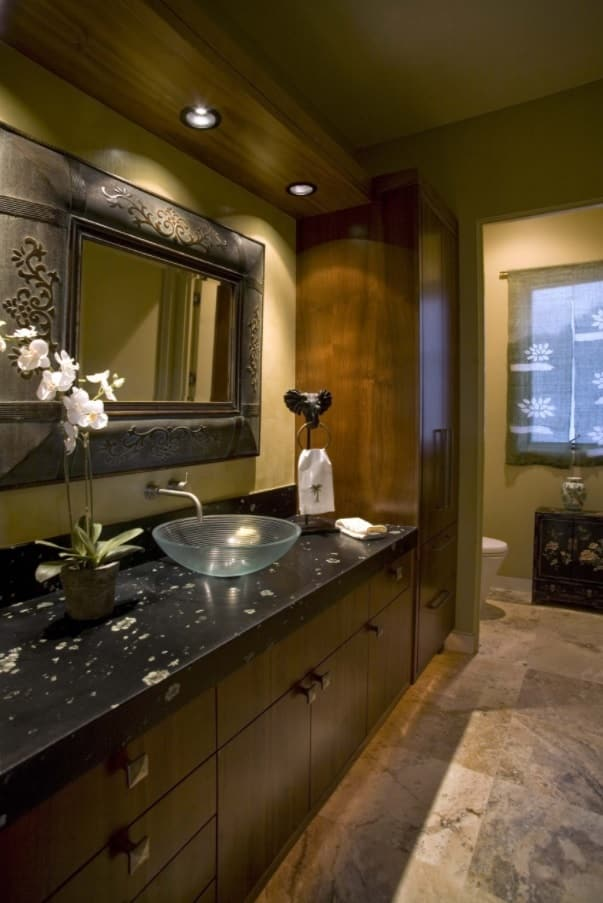 5 Ways to Improve Your Bathroom. Great dark scheme with marble and wood along with glass shell sink