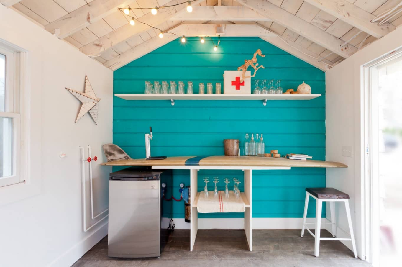 Alternative Ways to Use a Garden Shed. Patio bar at the backyard with turquoise accent wall
