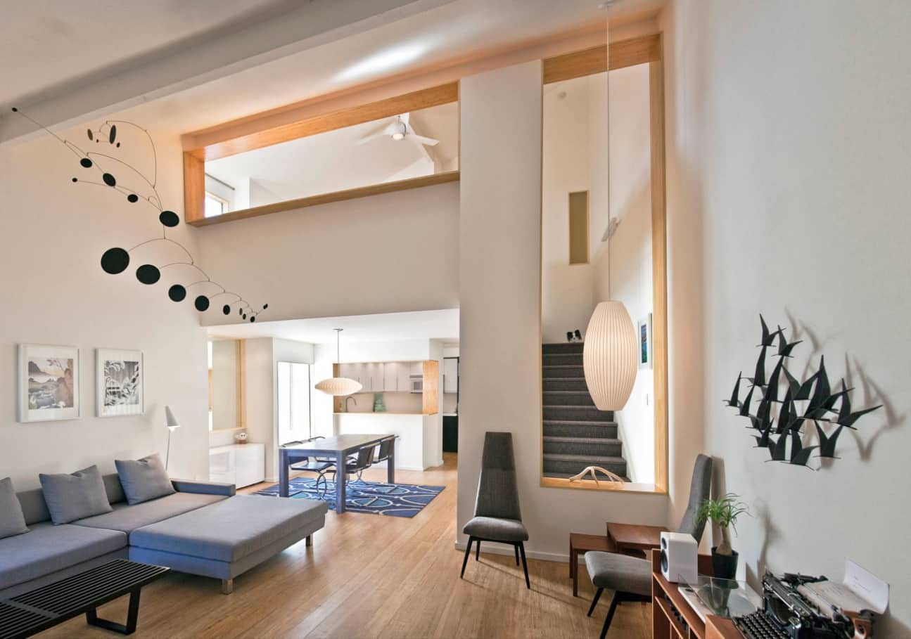 Best Townhouse Decor Ideas. Nice multilevel interior in white color full of wooden trim and wooden floor
