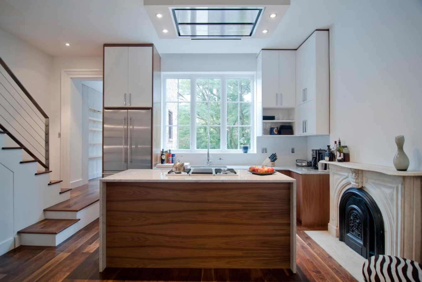 Best Townhouse Decor Ideas. Large window, white furniture, modern flat LED ceiling lamp and central kitchen island for contemporary space