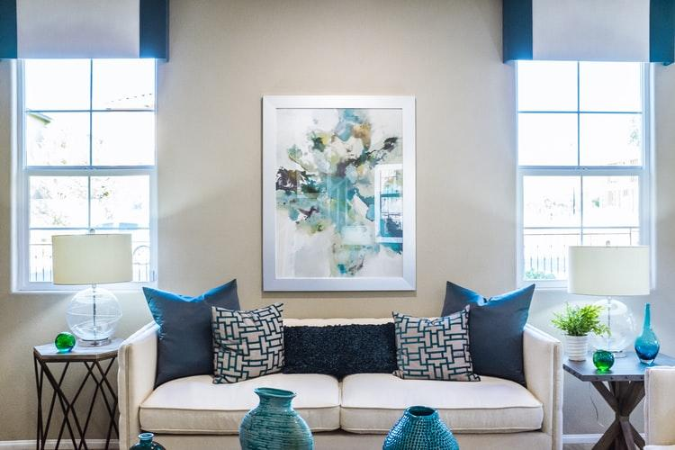 How to Make Your Home Feel Warm and Cozy. Contemporary living room in gray and blue color theme