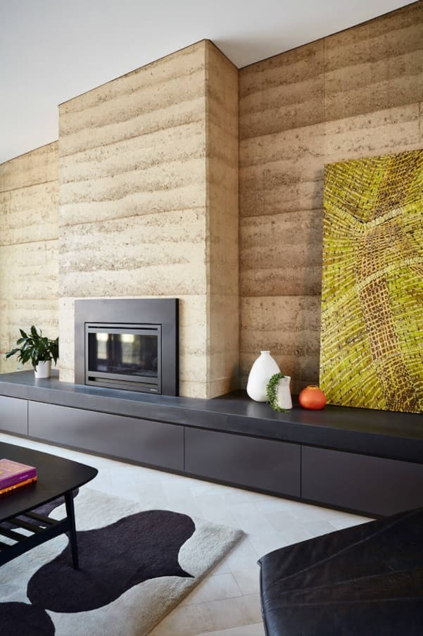 10 Ways to Stay Warm in Your Home without a Furnace. Nice spacious living room in modern arrangement with wooden wall paneling and electric fireplace
