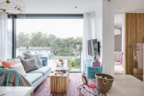 10 Ways to Stay Warm in Your Home without a Furnace. Rag at the floor in the minimalistic Scandi interior with panoramic window