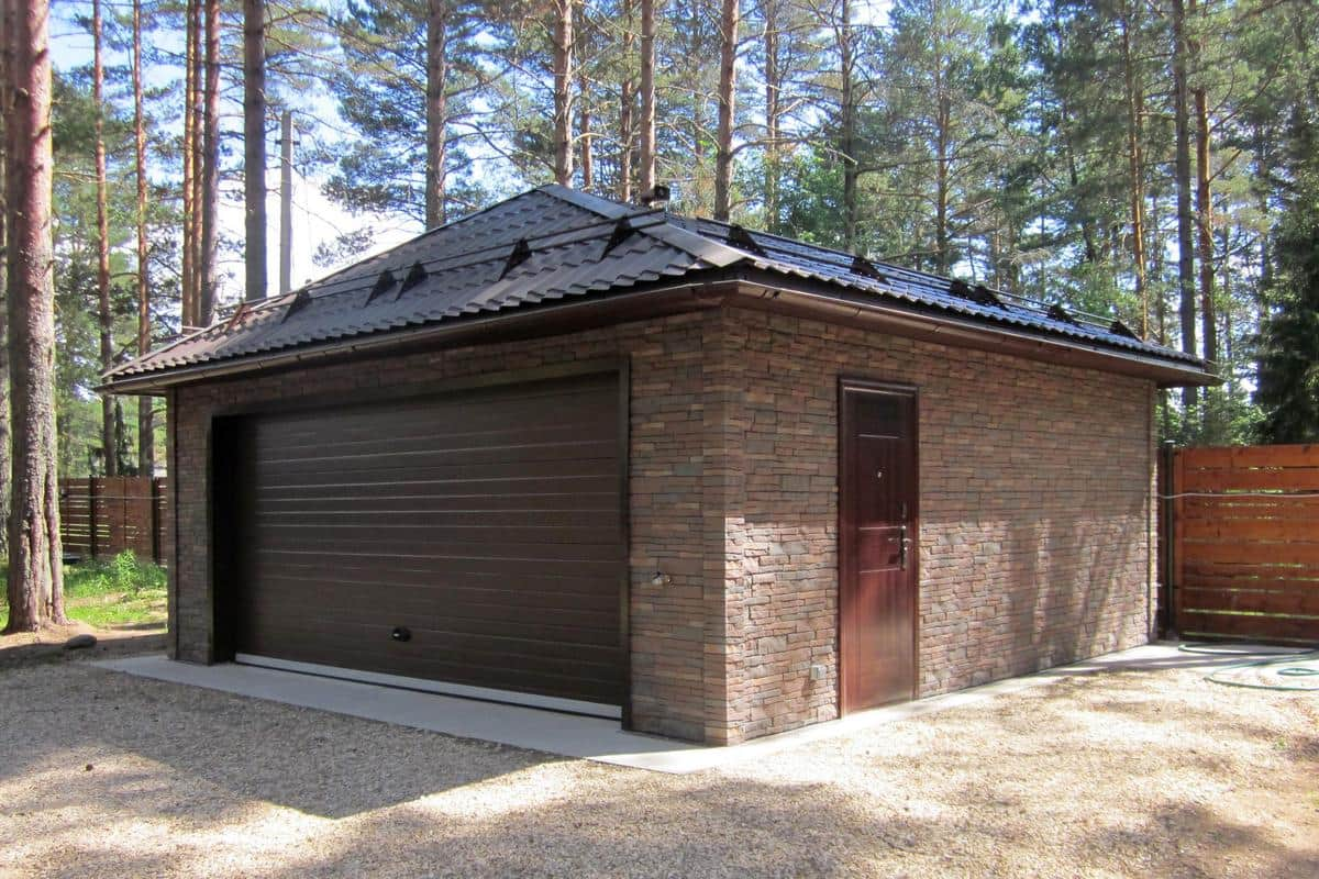 High-Demand Areas of Your Home That Attract Potential Home Buyers. Stone cladded separate standing garage with painted metal roofing