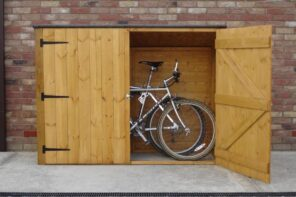 5 Steps to Select the Right Bike Shed. Simple wooden garage for a bicycle