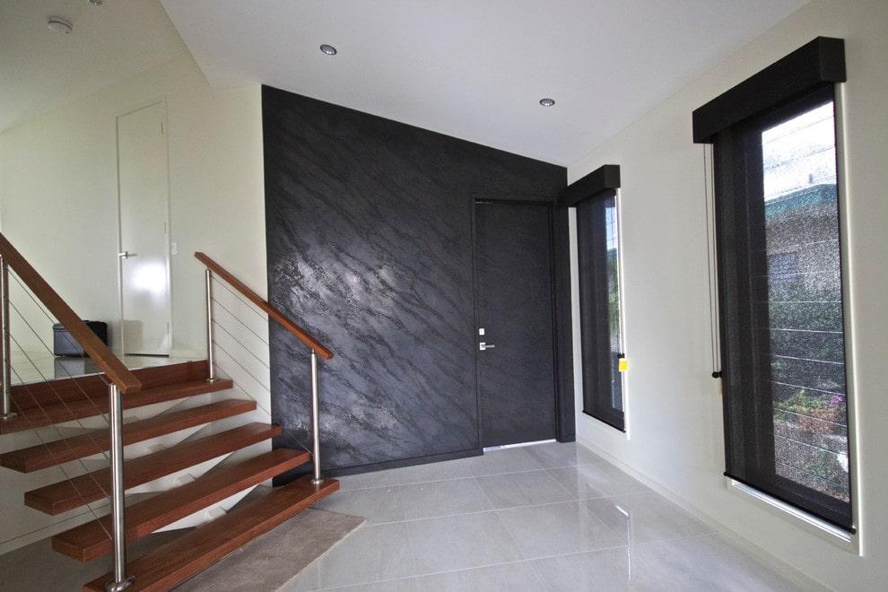 Wallpaper under the decorative plaster