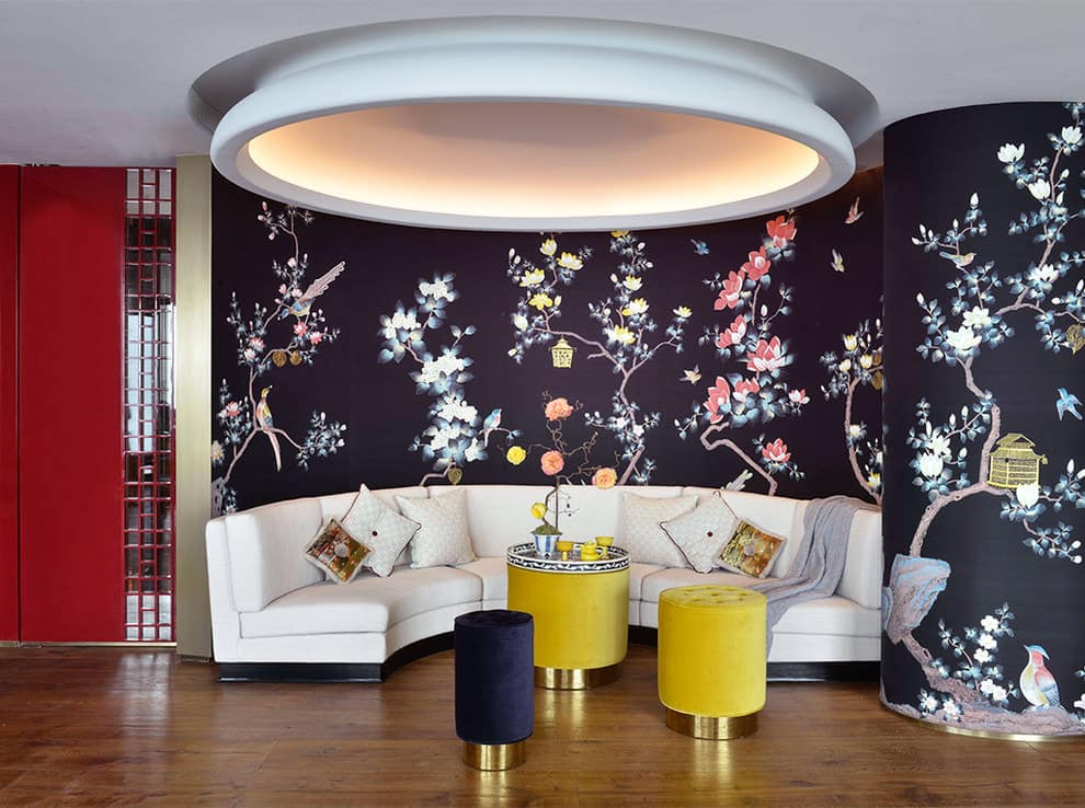 light furniture and black wallpaper with light floral motifs