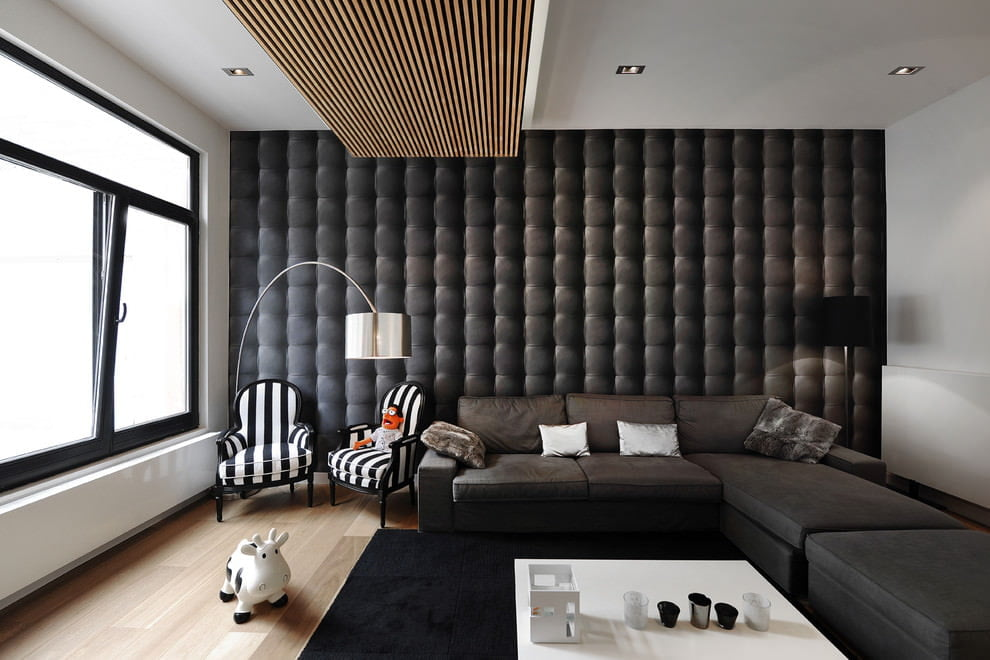 a stylish modern living room with voluminous 3D quilt imitation wallpaper