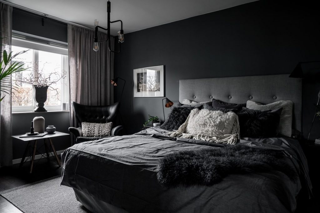 Decorating Ideas for Dark Bedroom Walls. Black walls and bedding in the modern styled room with quilted headboard