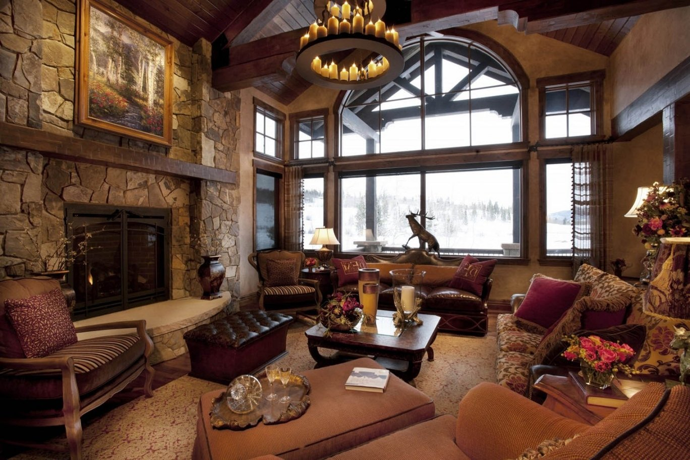 Chalet styled house interior with huge windows and candlesticks in the medieval chandelier