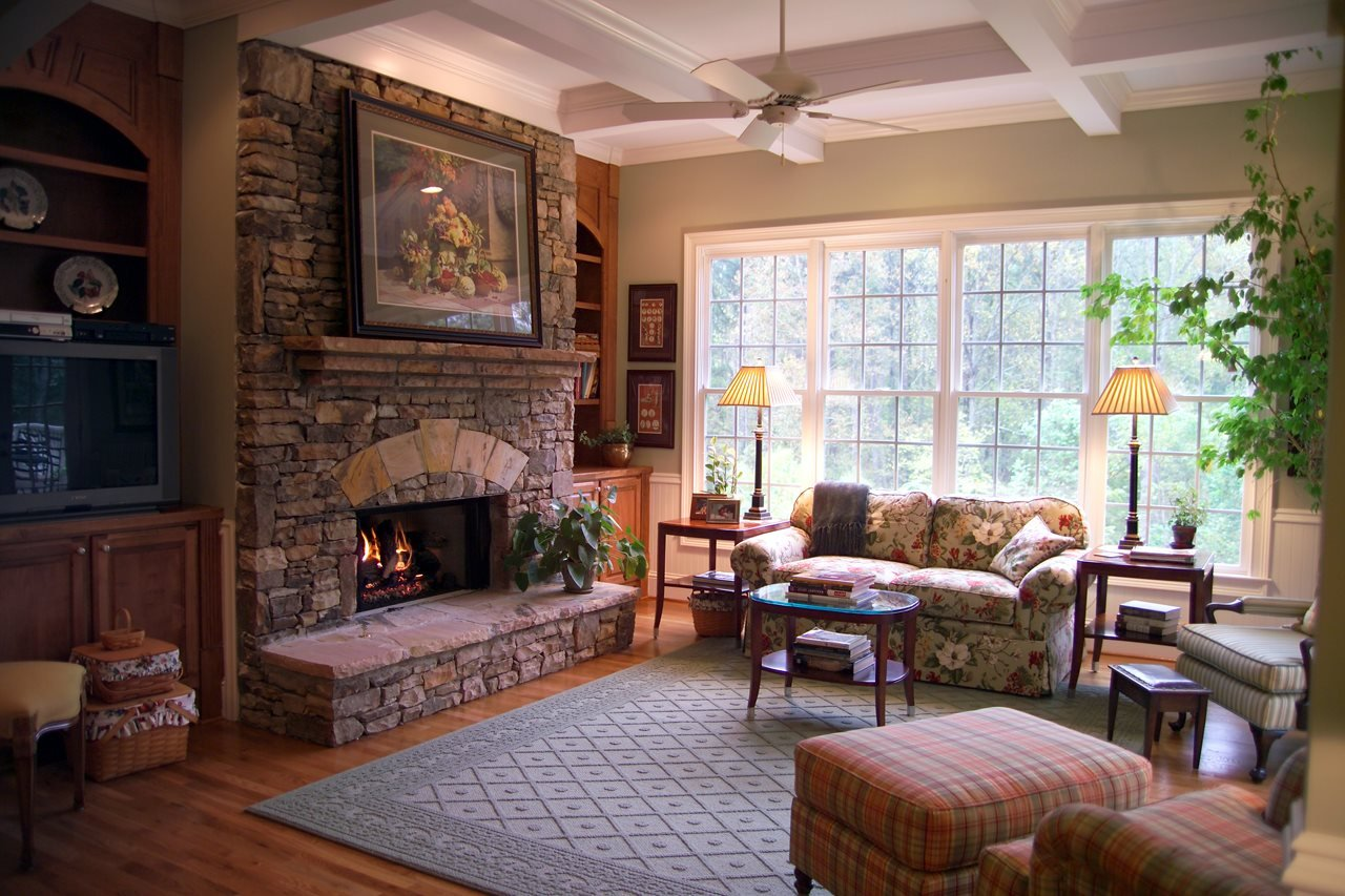 Stone cladded wall with the fireplace