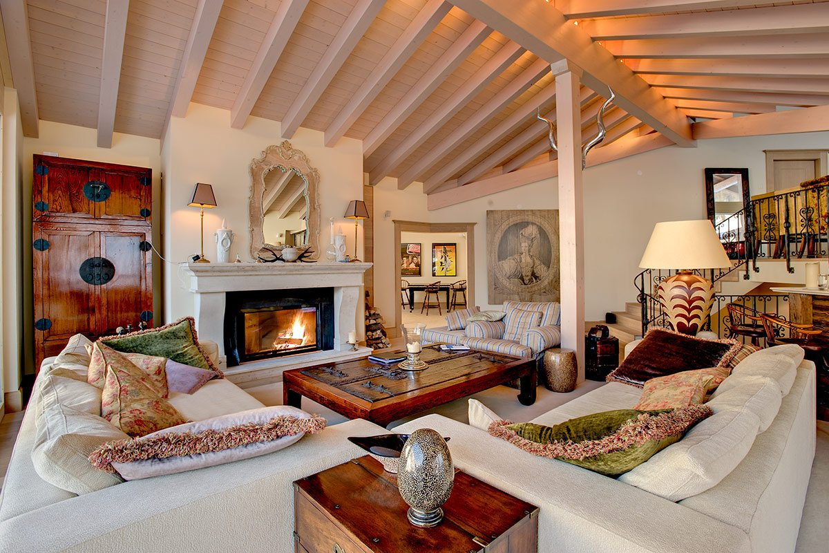 Painted white open layout interior of the private house with large wooden coffee table