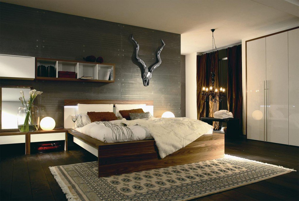 Accent black headboard wall in the German styled bedroom with large platform bed