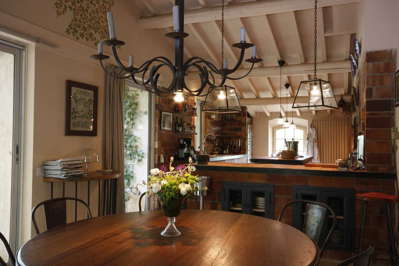 German Interior Design Style Overview and Examples. Chalet looking room with candlestick chandelier and large wooden table