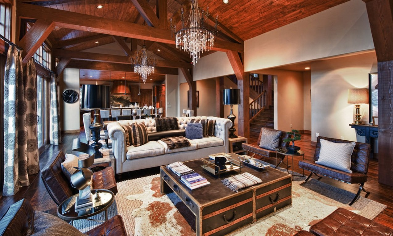 great castle looking interior design with wooden transom ceiling, cow pelts and chest coffee table