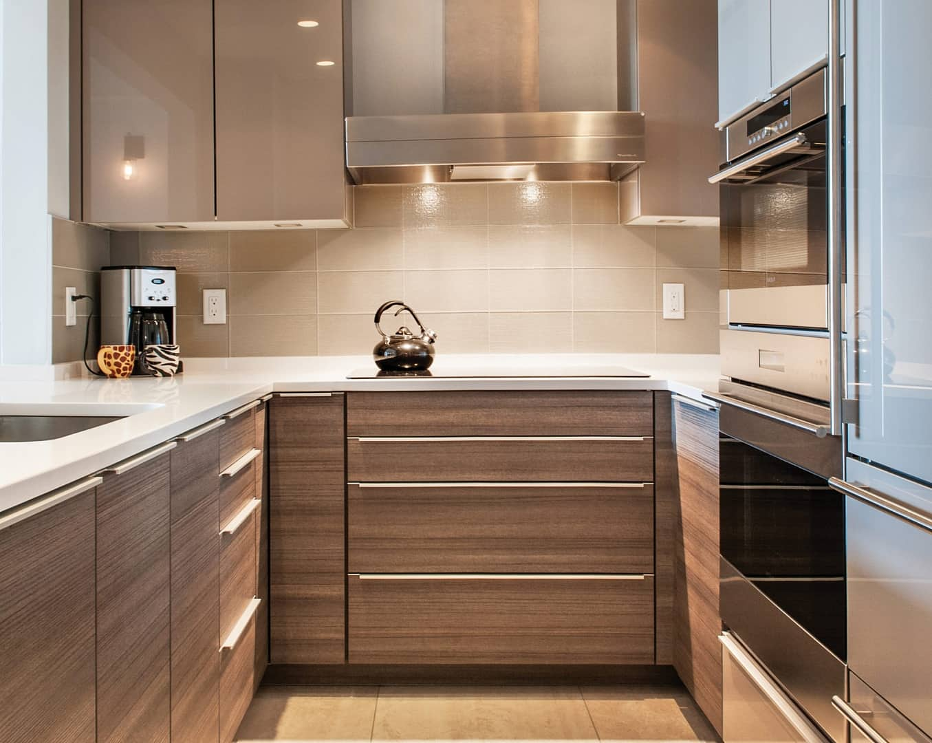Kitchen Planning 101: The Ultimate Kitchen Remodeling Guidelines. U-shaped kitchen design with wooden facaded furniture and lots of LED fixtures