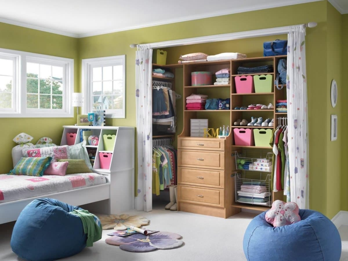 How to Maximise the Space in Your Home. Olive green painted walls for casual styled interior with great hidden storage system