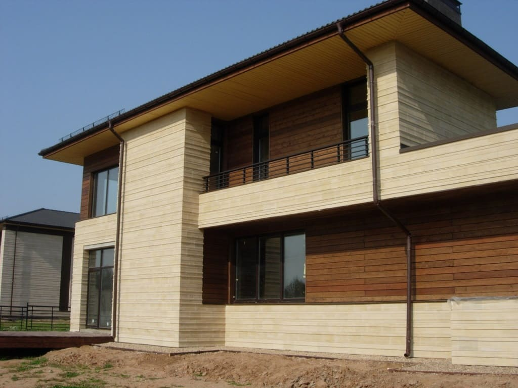 5 Tips On Choosing The Right Cladding For Your House. Combined facade with light wooden trimming