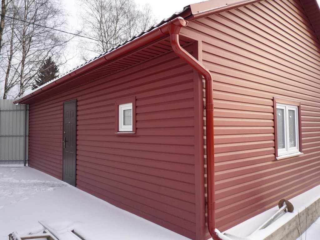 5 Tips On Choosing The Right Cladding For Your House. Original red vinyl facaded cottage