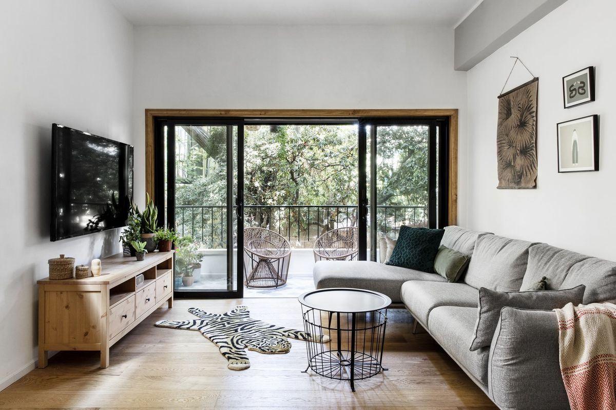 Selling Your House? Here Are 6 Ways to Make It More Attractive to Buyers. Black framed balcony door block for the modern styled living room with TV on the stand and zebra pelt imitation on the floor
