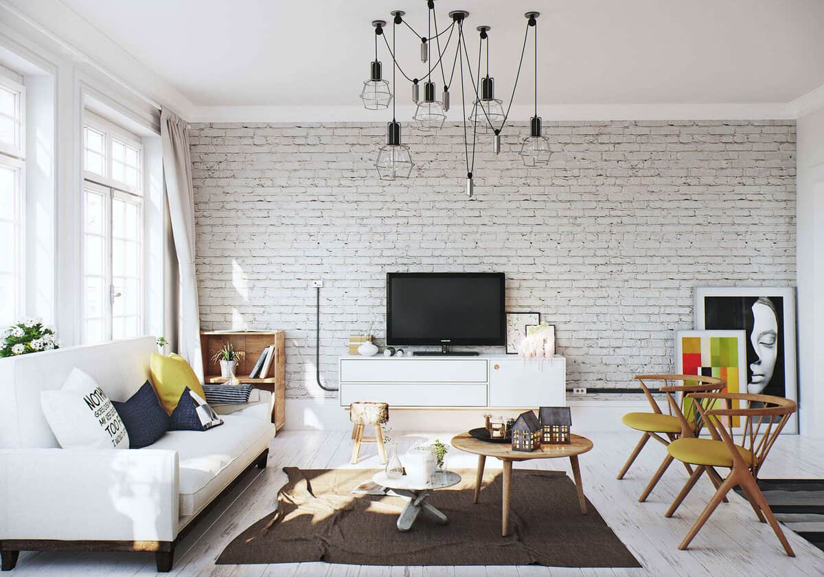 Selling Your House? Here Are 6 Ways to Make It More Attractive to Buyers. Whitewashed brickwork accent wall in the white painted living room with spider chandelier to add the touch of Steampunk