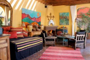 Spanish Interior Design Style Overview. White walls and colorful textiled for large living room
