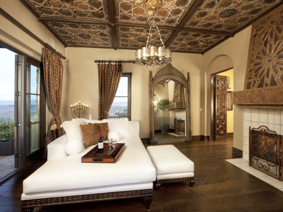 Spanish Interior Design Style Overview. Noble and luxurious bedroom interior with gold and brown tints