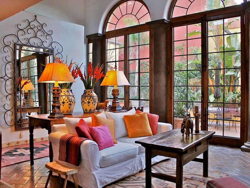 Spanish Interior Design Style Overview. Large stained glass windows and colorful textile to decorate large private house's parlour