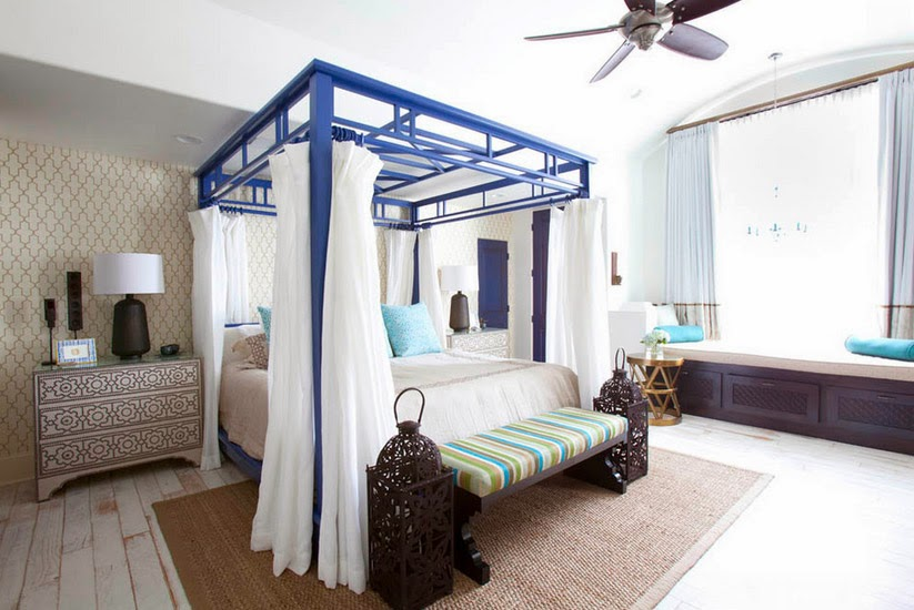Bed Canopy in the Bedroom Interior Photo Ideas. Gorgeous blue frame for the king-size bed with an ottoman