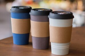 5 Cool Custom Coffee Sleeve Designs That You Should Try! Plastic coffee glass with paperboard sleeve